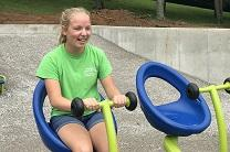 Rachel Ritchie plays on the inclusive playground that she raised 100,000 dollars to build.