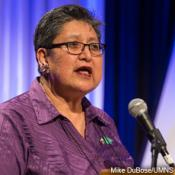 Cynthia Kent, chairperson of the Native American Intl. Caucus, helps lead worship at the Pre-General Conference Briefing in Portland, Ore. Photo by Mike DuBose.