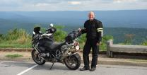 The Rev. Randy Shrauner poses beside his motorcycle. He will join friend the Rev. Dennis Miiler on a motorcycle trip to the Arctic Ocean to raise money for Imagine No Malaria. Photo by Dennis Miller, courtesy of Imagine No Malaria.