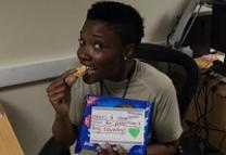 A U.S. soldier enjoys a cookie sent by members of Alpharetta (GA) UMC. Image courtesy of Alpharetta UMC.