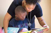 Servant-Leader Intern Deidre Thornton helps student Jonathan learn a new word at the Freedom School at Gordon Memorial United Methodist Church in Nashville, Tenn. Photo by Mike DuBose, UMNS