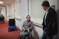 Rev. Uwe Onnen talks to a resident in the church's care home in Hamburg, Germany. Video image by United Methodist Communications.