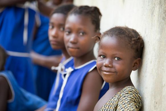 Children stand outside a town hall meeting in Fulawahun village near Bo, Sierra Leone in March 2014. Photo by Mike DuBose, UMNS