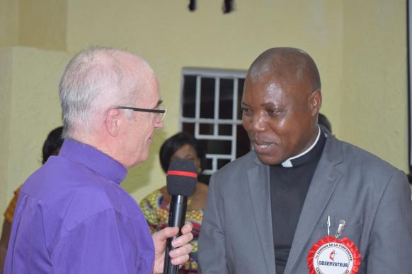 Bishop Patrick Streiff (left) of the Central and Southern Europe Episcopal Area greets Bishop Daniel Onashuyaka Lunge after his election. Photo by Eveline Chikwanah, United Methodist Communications
