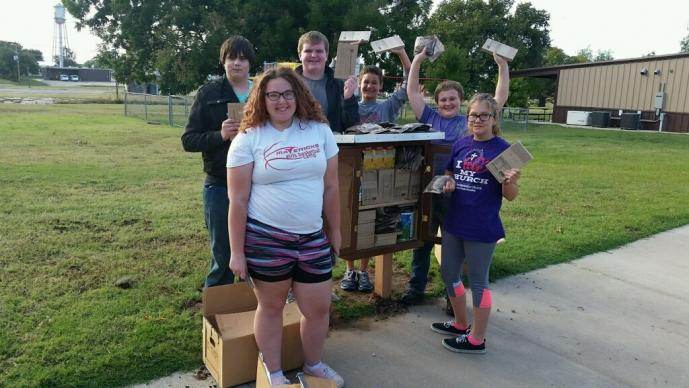 Youth from First United Methodist Church in Tonkawa, OK, fill the Box of Blessings for the first time.