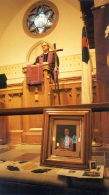 The Rev. Bruce Cook, founder of CVAC, delivers a homily to family members of homicide victims during a memorial service at Northside United Methodist Church in Atlanta. Photo by Bruce Cook