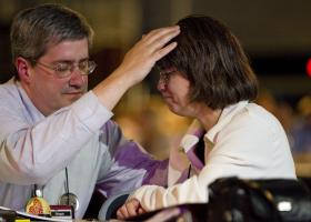 The Rev. Dan Dick and Lisa King pray together during evening worship at the 2012 United Methodist General Conference in Tampa, Fla. Photo by Mike DuBose, UMNS