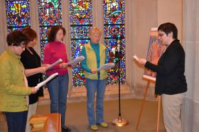 The Rev. Kathy Barba Pierce (right) leads the meditation as Ivey Orr, Marti Holcombm Miriam Ward and Lisa Cheek make travel to the 'Stations of the Resurrection' at Wesley Memorial United Methodist Church in High Point, N.C.
