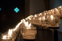Candles lit in memory of departed loved ones. Image by Stefan Schweihofer, Pixabay.com.