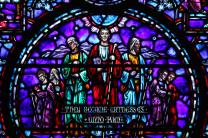 This section of the stained-glass window the at the Upper Room Chapel represents the disciples as they went forth to witness. Photo by Kathleen Barry, UMNS.