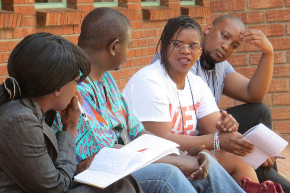 African communicators for The United Methodist Church worked in small groups, editing one another's articles, during a recent workshop at Africa University in Mutare, Zimbabwe. Photo by Sam Hodges, United Methodist Communications.