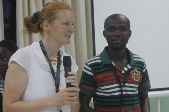 Sybille Fleischmann introduces Daniel Garba to give a day-end report on the work on their training session. Sybille led the training track on information and communication technology for development (ICT4D), and Daniel participated in the class in Abidjan, Côte d'Ivoire. Photo courtesy of United Methodist Communications, 2015.