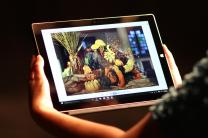 A beautiful cornucopia is featured on a tablet computer. Photo illustration by Kathleen Barry, United Methodist Communications.
