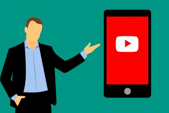 Illustration of man pointing to a mobile device with youtube on the screen. Illustration by Mohamed Hassan, Pixabay.com.