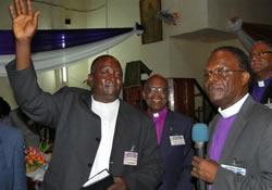 New Bishop John Wesley Yohanna (left) waves to supporters following his election in Nigeria in October. He leads the Nigeria Episcopal Area.