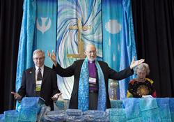 The Rev. Tom Albin (left), dean of The Upper Room chapel, joins now retired Bishop Timothy Whitaker and Frances Jennings, prayer ministry co-chair, to dedicate the Prayer Room at the General Conference 2012 in Tampa, Fla.