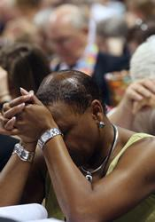 A delegate prays before voting during the 2008 General Conference in Fort Worth, Texas.