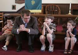 The Rev. Brian Rossbert leads prayer during children's time at New Bethel United Methodist Church in Pegram, Tenn.