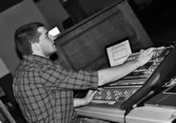 Jordan Romines runs the soundboard during a concert by a worship outreach team from Southwestern College in Winfield, Kan.
