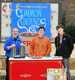 (From left) Dan Call, the Rev. Nathan Mattox and Ben Buchanan staff the Common Grounds Coffee Ministry stand, a part of University United Methodist Church's collegiate ministry.