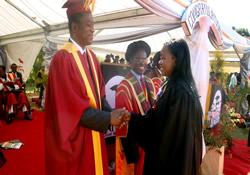 Africa University, receives congratulations from commencement speaker Geoffrey Onyeama. More than 400 students graduated in June 2012. The university celebrated its 20th anniversity throughout 2012.