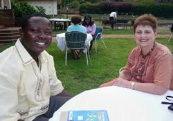 Christian Zigbuo visits with the Rev. Mary Beth Byrne from Indiana, during a fellowship event around graduation in June 2012 at Africa University. He received his education through a scholarship funded by the Indiana Annual Conference.