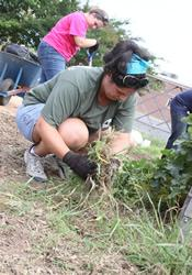 Shyloe O'Neal joins others working in a community garden at Duke Divinity School.