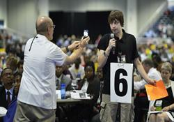 One delegate uses a camera phone to capture a video of another during the 2012 United Methodist General Conference in Tampa, Fla.