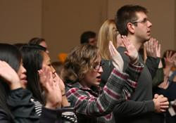 Young adults join in worship during Exploration 2011 in St. Louis.