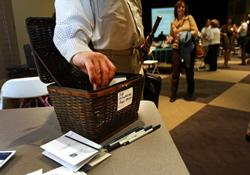 An attendee at the Roswell (Ga.) United Methodist Church Job Networking Ministry adds a slip to the prayer request basket.
