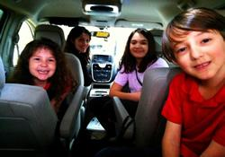 Drive time is now devotional time for Susan Elswick (second from the left) and her children Abigail, 5, Charlotte, 10 and Liam, 7.