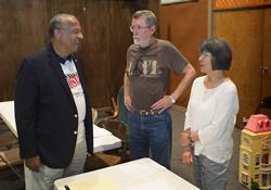 Oklahoma Bishop Robert E. Hayes (left) visits volunteers David and Geraldine Gill of the Oklahoma Indian Missionary Conference in the Native American Disaster Response Center at New Life United Methodist Church in Moore, Okla.