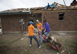 Members of a volunteer team working out of First United Methodist Church in Moore, Okla., remove concrete rubble from the home of Ronald Samaniego. From left are Jennifer Morgan, Mel Rogers and Stephanie Birdwell.