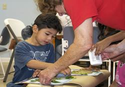 Volunteers from St. John's United Methodist Church in Winter Haven, Fla., work closely with children during