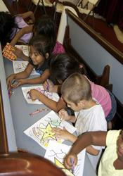 Pews in the former Eloise United Methodist Church are a great place for younger children to color during