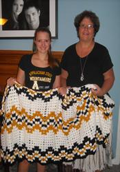 Karen Marlow (right) knitted the large prayer shawl that Catherine Allen received a few weeks after enrolling at Appalachian State University. The shawl features Allen's school colors. Both are members of Bon Air United Methodist Church.