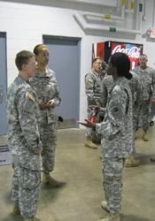 Chaplain Catrena Talbert (right) talks with members of her National Guard unit.
