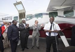 Pilot Gaston Ntambo (at microphone) speaks during a service of blessing for the new Wings of the Morning airplane at Dayton International Airport in Ohio. He is flanked by (from left, foreground): Bishops Nkulu Ntanda Ntambo and Gregory V. Palmer and George Howard of the General Board of Global Ministries.