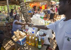 Madame Espady sells food and household goods from her market stall in Mizak, Haiti. She has received a microcredit loan from Haiti Artisans for Peace International (Advance #3020490).