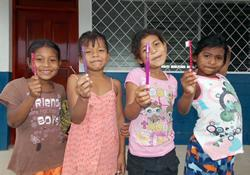 No matter where they live, kids like new toothbrushes!