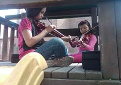 Young violinists perform a playground concert at Emmaus United Methodist Church, home of RISSE