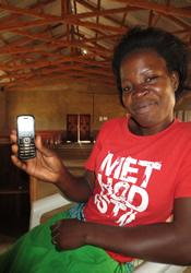 Prisca Nethulu receives her first text message sent via FrontlineSMS. Nethulu is in Madisi, Malawai.