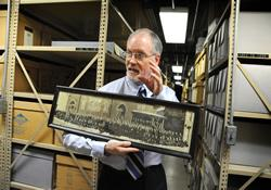 Archivist Dale Patterson describes the storage system at the General Commission on Archives and History in Madison, N.J.