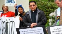 The Rev. Mark Galang (second from right) joins a demonstration advocating a living wage for workers at the Seattle-Tacoma International Airport. Courtesy photo