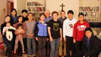 The Rev. Yohang Chun (fifth adult from left) hosts college students in his home on Friday nights. Photo by Shannon Hodson, Upper New York Advocate