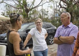 (From left) Denise Santos, the Rev. Laura Ice, and Bob Cholka talk outside at Goodland distribution center located on the tip of Marco Island, Fla. This community was hit hard by Hurricane Irma. Santos is a volunteer from Goodland, Ice is the director of disaster response for the Florida Conference and Cholka is chairperson of the Wesley United Methodist Church council on Marco Island. Photo by Kathleen Barry, United Methodist News Service