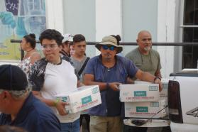 Volunteers from the Methodist Church of Puerto Rico -- including many whose own homes were damaged -- have been on the front lines of distributing water and food. Photo by Gustavo Vasquez, UMNS