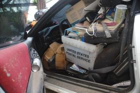Some Puerto Ricans attempted to save important documents and other valuables by putting them in their cars. As the flood waters swamped the vehicles, though, many of the items were destroyed. Photo by Gustavo Vasquez, United Methodist Communications