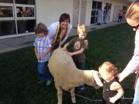 The Rev. Ginny Wheeler joins youngsters in a Blessing of the Animals during Heifer Sunday at Community United Methodist Church in Huntington Beach, Calif. Photo by James Jones