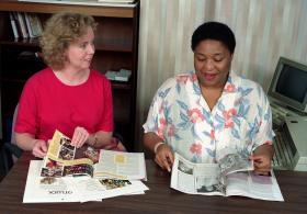 Editor Garlinda Burton (right) and Amy Wallace Brack review an issue of Interpreter in the late 1990s-early2000s. Photo by Mike DuBose, United Methodist Communications